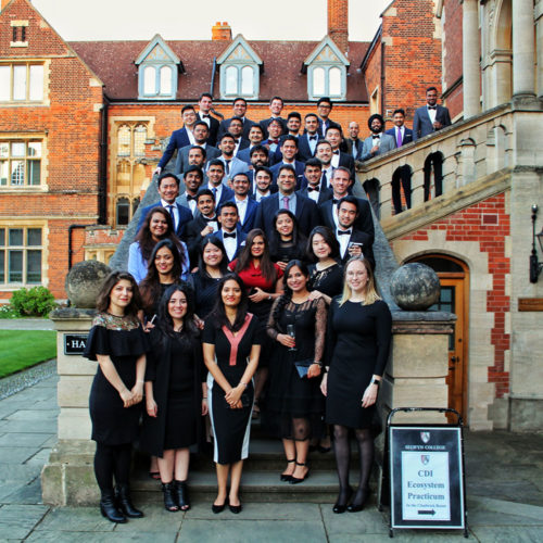 Students of the MME TIME on stairs at Cambridge University