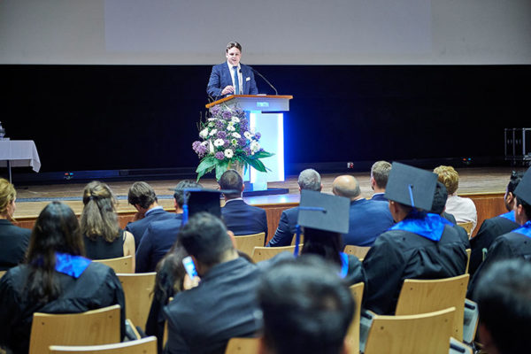Dr. Helmut Dinger delivering his speech at the graduation of the MME TIME