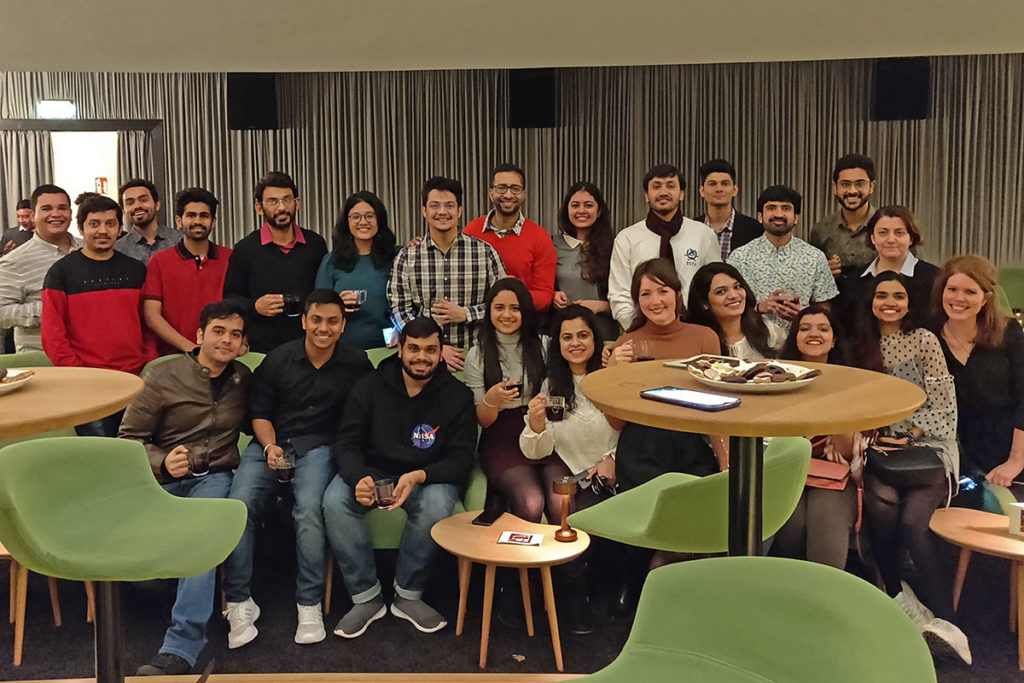 Group picture of students during the christmas party at the cinema with mulled wine