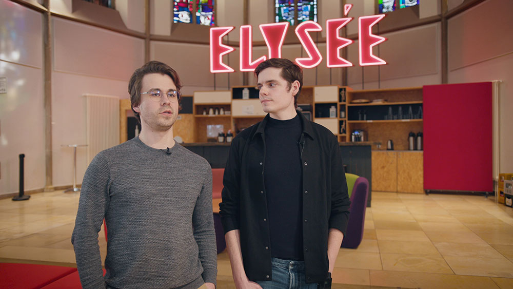 Two young men standing in the Digital Church giving an interview
