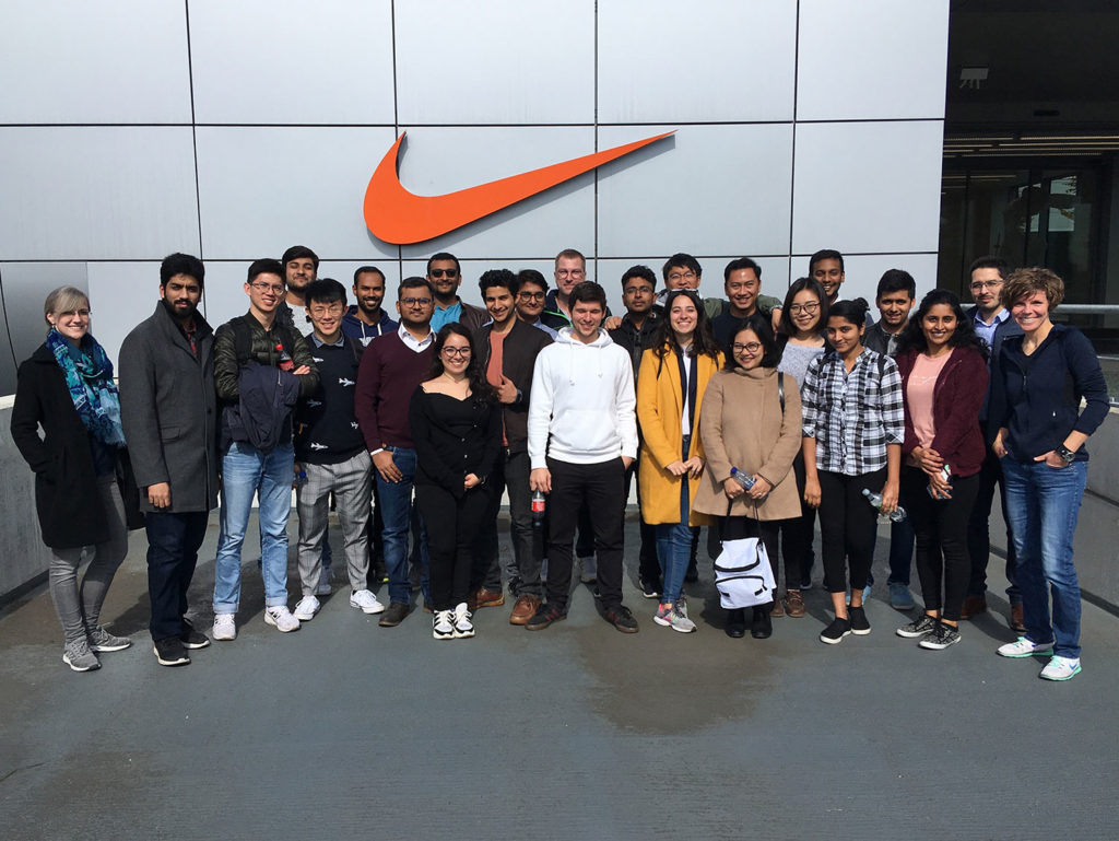 "Students at the NIKE ELC in Laakdal in front of the ""Swoosh""."