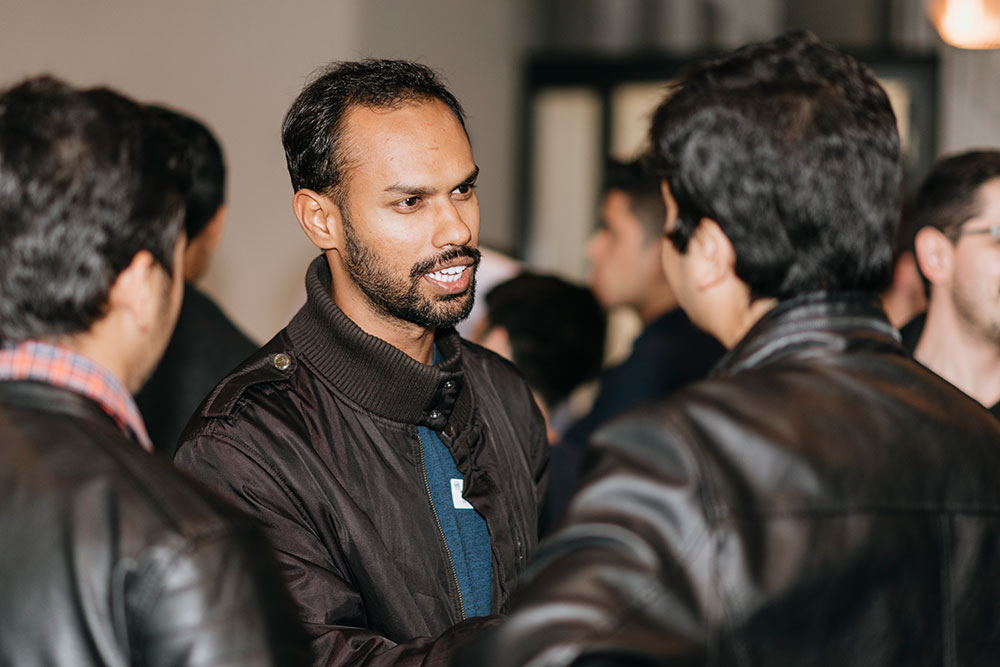 Nikhil Kulkarni talking to other students of RWTH Business School during Welcome Event