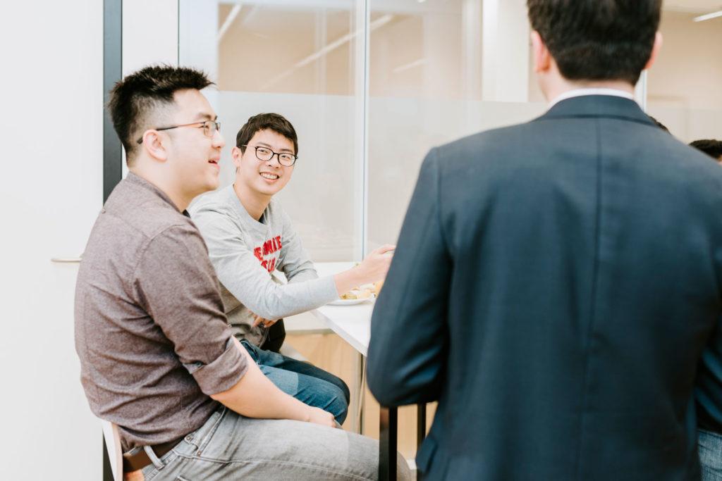 Students talking to Professor